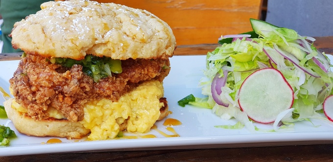 Fried Chicken on a Buttermilk Biscuit with soft scrambled eggs